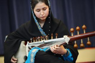 Negin Khpolwak, of the Afghanistan National Institute of Music, performs in the Dean Acheson Auditorium in February 2013 in Washington, DC