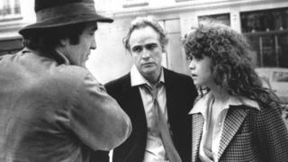 Bernardo Bertolucci (left) with Marlon Brando and Maria Schneider