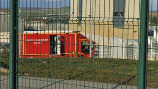 An emergency vehicle at a French nuclear waste site after a deadly rock slide