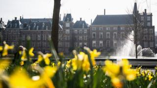 The Dutch parliament building with flowers in front of it