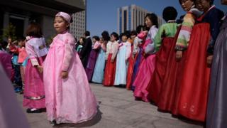 People wearing traditional Korean 'hanbok' dresses take part in a parade in the central Gwanghwamun square in Seoul