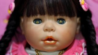 A picture made available on 25 January 2016 shows a Child Angels Dolls painted with holy gold sheets in its eyes and mouth,