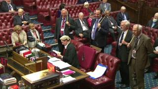 A clerk consults standing orders as peers await the result of the Wales Bill vote.
