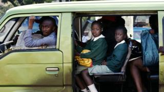 kenyan children going to scholl in a matatatu