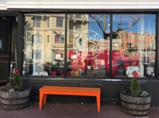 Orange Bench outside of Each Peach Market
