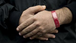 A man with a wristband on