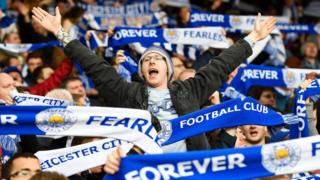 Leicester City fans cheer for their team