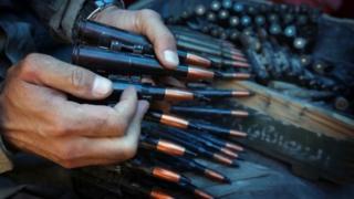 An Iraqi Kurdish holds a gun