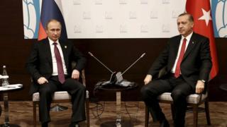 Turkey's President Tayyip Erdogan meets with his Russian counterpart Vladimir Putin at the G20 leaders summit in the Mediterranean resort city of Antalya, Turkey