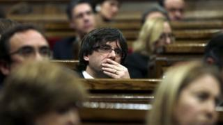 Carles Puigdemont reacts during his vote of confidence at the regional Parliament in Barcelona