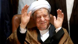 In this Dec. 21, 2015 file photo, former Iranian President Akbar Hashemi Rafsanjani waves to journalists as he registers his candidacy for the elections of the Experts Assembly, in Tehran, Iran. Iranian media said Sunday, Jan. 8, 2017,