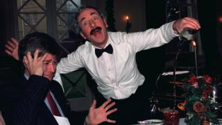Andrew Sachs acting the role of the hapless waiter Manuel from an episode of Fawlty Towers