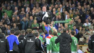 Manager Michael O'Neill was hoisted in the air by his overjoyed team