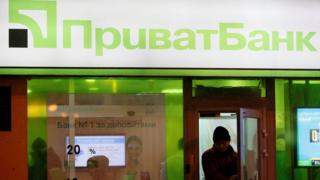 Man leaving a Privatbank branch