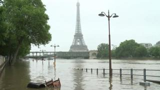 Image of river Seine at high levels with Eiffel Tower in distance - 4 June 2016