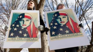 Demonstrators gather near The White House to protest President Donald Trump's travel ban on March 11, 2017 in Washington