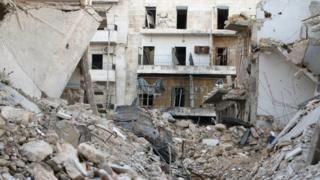 Graffiti is seen on a damaged building in Tariq al-Bab neighbourhood of Aleppo, Syria November 2, 2016