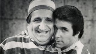 Al Molinaro, left, and Henry Winkler, right, in an episode of Happy Days