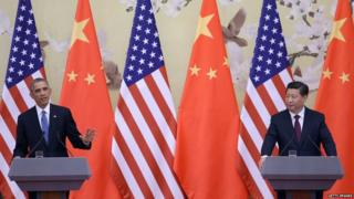 NOVEMBER 12: U.S. President Barack Obama (L) and Chinese President Xi Jinping (R) attend a press conference