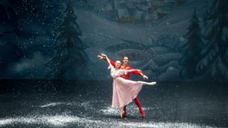 Two ballet dancers perform as the prince and Clara in The Nutcracker