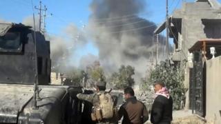 Smoke rises following a US-led coalition air strike in Ramadi on 25 December 2015.