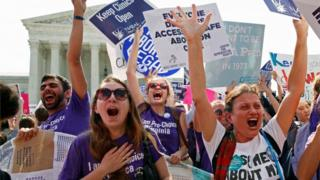 Protesters celebrate after the US Supreme Court strikes down a restrictive 2012 Texas abortion law.