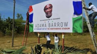 Billboard announcing President Barrow's inauguration