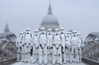 People dressed as stormtroopers from the Star Wars franchise of films pose on the Millennium Bridge in London to promote the latest release in the series. 15 December 2016