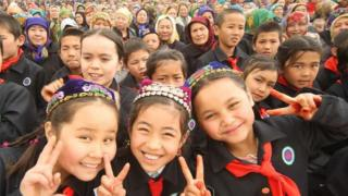 Children taking part in Nowruz celebrations in Hami (Kumul),
