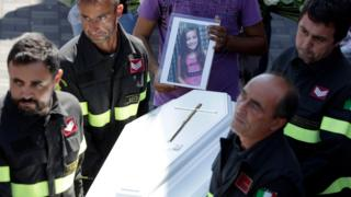 The coffin of Giulia is carried outside the gymnasium at the end of the state funeral service in Ascoli Piceno.