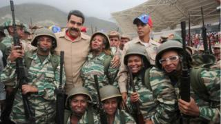 Venezuela's President Nicolas Maduro (back row 2nd L) poses for a photo with militia members during a military parade in La Guaira, Venezuela May 21, 2016