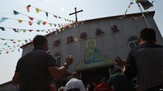 "This photo taken on May 24, 2015 shows worshippers celebrating the Feast of the Ascension at the ""underground"" Zhongxin Bridge Catholic Church in Tianjin. Tianjin,"