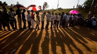 Ugandans continue to queue to cast their votes at sunset in the capital Kampala, Uganda on 18 February 2016