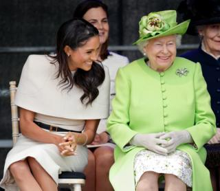 Meghan, Duchess of Sussex and Queen Elizabeth II attend a ceremony