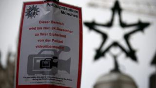 A police placard informs visitors that this Christmas market is under video surveillance in downtown Munich, Germany, 21 December 2016