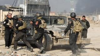Members of Iraq's elite counter-terrorism service gather in Ramadi