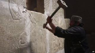 IS image from April 2015 reportedly showing militant taking a sledgehammer to an Assyrian relief