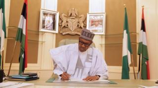 President Muhammadu Buhari at his desk on Monday