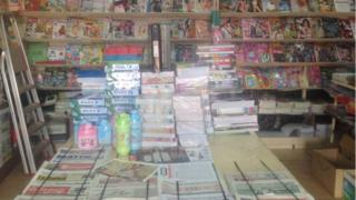 Newspapers displayed in a shop in Gabon