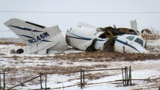 The wreckage of an airplane lies in a field Tuesday, March 29, 2016, in Havre-aux-Maison, Quebec
