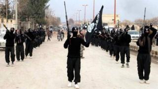 IS militants in Raqqa (file photo)