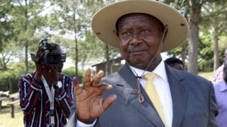 Ugandan President Yoweri Museveni shows his ink stained finger after voting in presidential elections