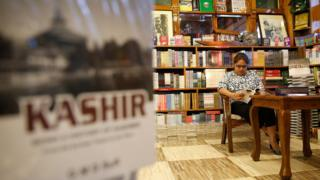 A girl reads a book in the Gulshan Books cafe
