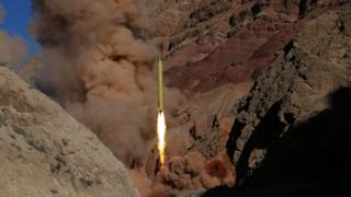 Qadr H long-range ballistic missile is fired during a manoeuvre in an undisclosed location in Iran
