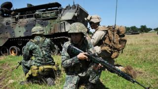 Philippine marines and their US counterparts taking part in annual Philippines-US amphibious landing exercise at navy base facing the South China Sea in San Antonio, Zambales province, north of Manila. 9 October 2015
