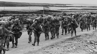 Argentine soldiers (troops) walking on their way to occupy the captured Royal Marines base in Puerto Argentino/Port Stanley