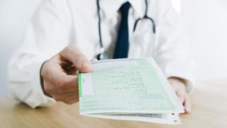 GP handing out prescription