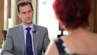 Syrian President Bashar al-Assad speaks to a journalist from Komsomolskaya Pravda