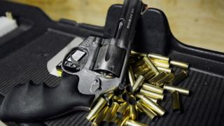 A Smith & Wesson.357 magnum revolver cools down at a target range at the Los Angeles Gun Club on December 7, 2012 in Los Angeles, California
