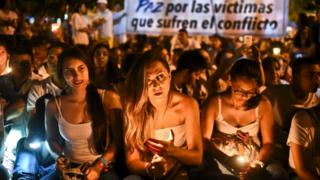 Demonstrators light candles during a march for peace in Cali, Colombia, on 5 October
